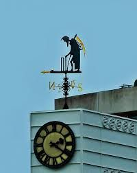 Father Time and the clock at Lords Cricket Ground in London.  He enacts Law 16 (3) of cricket: 'After the call of Time, the bails shall be removed from both wickets.' (http://www.lords.org/news/our-blogs/the-cricket-history-blog/father-time-and-the-lords-slope/)