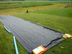 ginormous DIY slip and slide w/ plastic, velcro strips  pool noodle bumpers