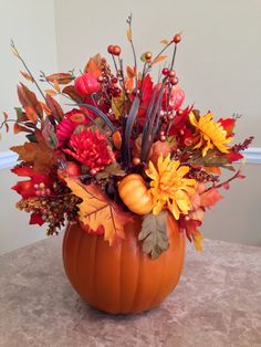 Small fake pumpkin floral arrangement.  #thanksgiving #red #Caps