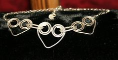 Sterling Silver Wire Heart Bracelet. Item matches Wire Heart Earrings and Wire Heart Necklace.   £15.00 plus P&P