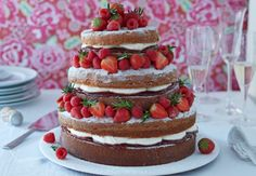 This show-stopping Victoria sponge cake boasts an impressive 5 tiers and is guaranteed to turn heads. | Tesco