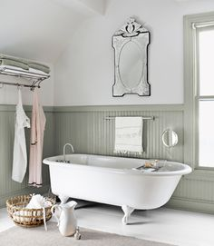 Conventional wisdom dictates white on wainscoting and color above, but the owner of thi