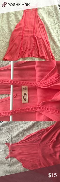 Long flowy tank top Hey guys! So right here I'm selling this pink long flowy tank top from hollister, it's size medium , and you could pair it with anything. It's a cute spring/summer piece. :) Hollister Tops Tank Tops