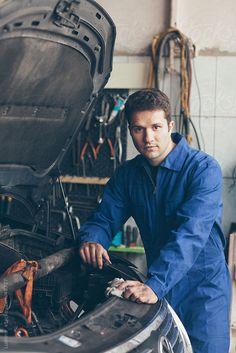 Mechanic Repairing a Car by Lumina