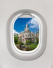 Looking out the window of a plane to the city of Amsterdam
