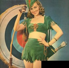 I couldn't resist sharing with you this poster from the It is Miss 'Robin Hood' Hunter, apparently advertising an archery competi. Target Lady, Archery Competition, Woman Archer, Archery Tips, Medieval Music, Pin Up Posters, Carnival Costumes, Playing Dress Up, Peter Pan