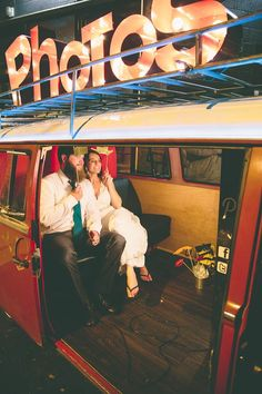 Happy newlyweds! The Photo Bus is such an awesome photo booth for a wedding in…