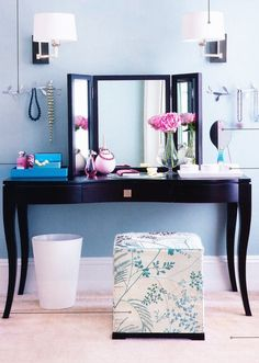 Dressing tables can be modern. I love the lighting with this & the triple mirror. Very Chic look.