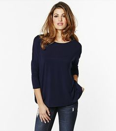 Feel totally relaxed but still sexy with this dark blue dolman sleeve top.