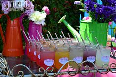 Lemonade rainbow on a vintage bar cart, with all different flavors and cute floral paper straws