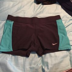 Nike dry-fit shorts Spandex fit Nike dry-fit shorts. Black and Aqua color! Size small! Nike Shorts