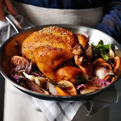 This blood orange roast chicken recipe calls for compound butter—softened butter combined with thyme, blood orange zest and garlic.