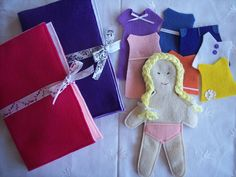 Quiet Activity Felt Dress Up Doll With Clothes and Case. $16.50, via Etsy.