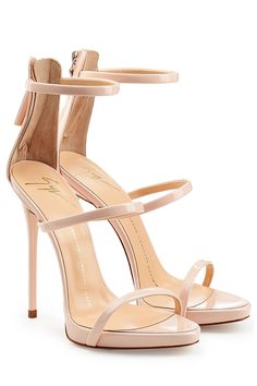 A high-style companion to everything from jeans to cocktail dresses, Giuseppe Zanotti's strappy sandals feature glossy nude patent leather uppers and extra flattering wafer platforms Nude patent leather uppers, thin straps, zippered back counter, nude leather lining and footbed Stiletto high heel Showcase with cropped, cuffed jeans