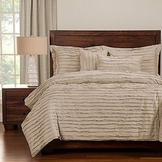 Give you bedroom a stylish makeover with the Tattered Duvet Cover Set. In a solid color, the beautiful set features luxuriously soft pieced fabric stripes for an elegant textured look. Including the comforter insert, the set will refresh your space.
