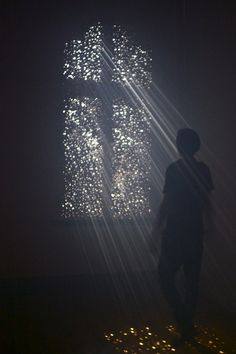 A Religious Experience (Installation) 2012 Plywood, Sunlight, and Fog Machine  20ft x 10ft x 20ft  Three windows were covered with plywood in the Athenaeum Music and Arts Library in La Jolla. Holes were drilled in the plywood for the stars of...