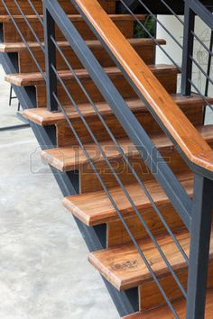 brown wooden staircase with iron banister in modern house Stock Photo