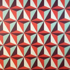 Red, Maroon, Blue & White Triangular Geometric Pattern