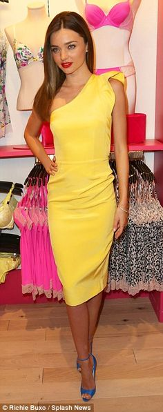 Let the sunshine in: Miranda ensures that all eyes are on her in the stand-out lemon yellow shift dress and bright blue stilettos