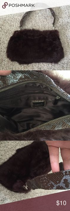 Besso brown faux fur purse Cute little shoulder bag. Snake skin print handle with faux fur body. Inside is lined and can hold keys, makeup, cash, cards, phone etc.  *** I offer a 15% off bundle discount and a free gift with every bundle! *** Besso Bags Shoulder Bags