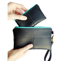 This black evening clutch is part of a matching set, a deliciously coordinated set for any time youre going out.  The ESSENTIAL set contains three coordinated accessories that will ease your day and delight your eyes. Each set has a key fob, coin purse, and wristlet clutch made in delicious vegan leather. Carry your keys, cards, cash, and phone with each impeccably-made piece. Choose from gold or silver hardware to match your style or your mood. Working together, this set will make your day…