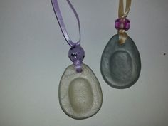 mothers day finger print pendants to make with my preschool class .these my test run -