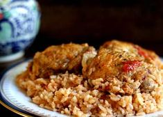 Classic dish of Spain and Latin America, this arroz con pollo recipe is browned chicken cooked with rice, onions, garlic, and tomatoes.
