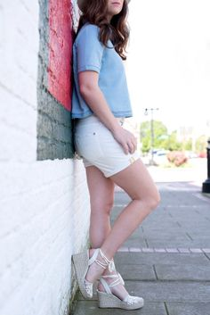 I am in love with this little denim crop top. It looks great with distressed white shorts and lace up espadrille wedges. Comfortable top for lazy summer days! From I Do Declare Blog.
