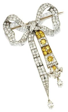 MY DIAMONDS  |  DIAMOND BOW BROOCH, CIRCA 1900, Old European-cut, pear-shaped and single-cut diamonds weighing approximately 10.00 carats, pear-shaped and old European-cut diamonds of fancy color weighing approximately 3.75 carats, mounted in gold and platinum.