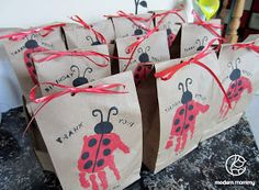 Modern Mommy: A Ladybug Birthday Party...Cute handprint bags.