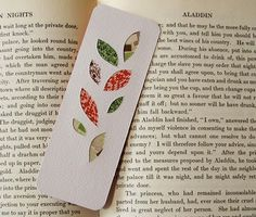 Homemade bookmark using punches; silhouettes backed with paper scraps, then covered.