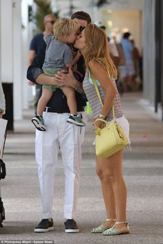 Kisses all round! The family share a little affection as they go shopping in Bal Harbour...