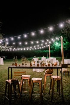 Our Café Lights hung in a fun zig-zag pattern helped to illuminate this simple yet charming backyard wedding reception! See more ways we hang our café lights by checking out our portfolio! #BackyardWedding #OutdoorReception #CharmingWedding #CafeLights #WeddingLightingIdeas Wedding Reception, Our Wedding, Reception Ideas, Event Services, Scenic Design, Simple Weddings, Hanging Lights, Event Decor, Wedding Decorations