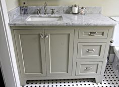 Love the color of cabinet for a bathroom. Not a fan of the counter top.