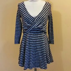 NWOT Free People Striped Dress Maroon and black/white striped faux wrap top with deep V front and back with full skirt approximately 17 inches long. Fully lined in black except for the sleeves. Very comfortable and versatile 62% polyester 38% cotton NEVER WORN Free People Dresses