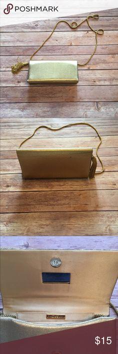 Little vintage gold cross body purse Gently used fun gold cross body purse. Has little mirror inside. Tassel on end. Vintage style Preston & York Bags Crossbody Bags