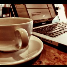 An empty coffee shop, coffee and my laptop. All I need on a nice Spring morning