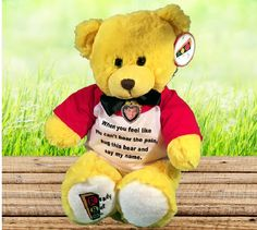 "Designed for anyone who has lost a loved one. The 15"" Yellow plush male Brian bear. The Brian boy bear wears a black tie and a red and white T-shirt. (The Brianna girl bear has pink ribbons on her head.) ""When you feel like you can't bear the pain, hug this bear and say my name."" Cherish the picture that you have placed in the locket, and always remember to: Get ready to carry on, Set a goal, and Go out there and honor your loved one."" Each bear wears a beautiful heart shaped locket adorned…"