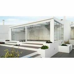 Giardino d'inverno in stile in stile Minimalista di all Design e Arquitectura de Interiores