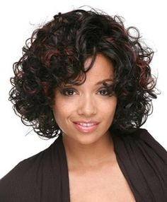 Short curls with a hint of red highlights