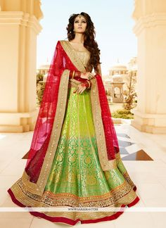 This pretty piece is a fairy tale that begins to unfold as you reveal your beauty in it. Include yourself in the glamour of the season with this elegant green viscose and banarasi silk a line lehenga ...