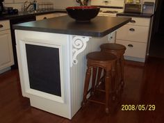 Interesting chalkboard placement on Kitchen Island - my son would love this!