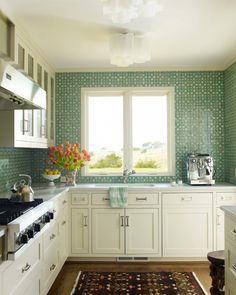 DESIGNER KATIE RIDDER - Aqua mosaic tiles form a counter to ceiling backsplash in an otherwise white kitchen. Description from pinterest.com. I searched for this on bing.com/images