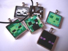 Minecraft Pendant. 6 different Mobs (Zombie, Creeper, Slime, Enderman, Cow, Skeleton). Black leather cord with lobster clasp included.. €9.70, via Etsy.