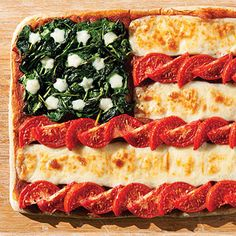 For a fun, festive Fourth of July dinner, use spinach, sliced tomatoes, and mozzarella cheese to create this special pizza.