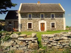 Glanthagh Farmhouse - Irish traditional two-story thatch cottage.