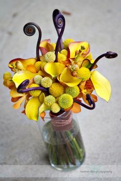 yellow calla bouquet with orchids, fiddle head fern and billy balls  Wedding flowers by Sophisticated Floral Designs. Portland, OR http://sophisticatedfloral.com/