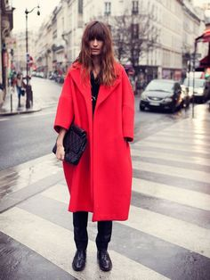 caroline de maigret red over coat. over sized pop of color coat #statement #coat #winter