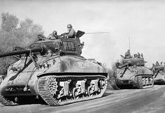 French tanks patrol a North African road near Blida, Algeria, on Nov. 4, 1954 seeking Guerrilla bands hidden in the hills after starting a nationalist uprising. Rebel raids on towns, bridges and communication systems produced a challenge to French control of Algeria. European settlers were evacuated from the troubled Tunisia-Algeria border area where the most violent raids were concentrated.  Photo credit: AP Photo