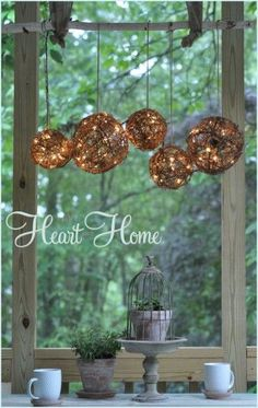 Make your own chandelier with grapevine balls, white lights, twine, and a branch. It's rustic and can be hung from a porch or patio.
